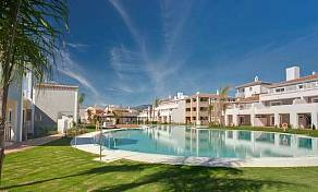 New apartments in gated complex with swimming pool and garden