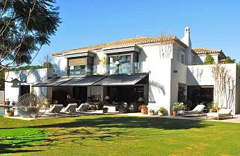 Magnificent contemporary style beach side villa situated in the most exclusive area of the Golden Mile, next to the Marbella Club Hotel