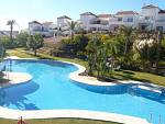 Southwest facing 2 bedroom first floor apartment in the gated development in Nueva Andalucia